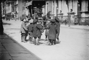 Children playing in the street circa 1900